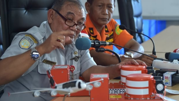 Tatang Kurniadi, the head of the National Transportation Safety Committee, speaks to journalists while using samples of the flight data recorder and cockpit voice recorder earlier this month.