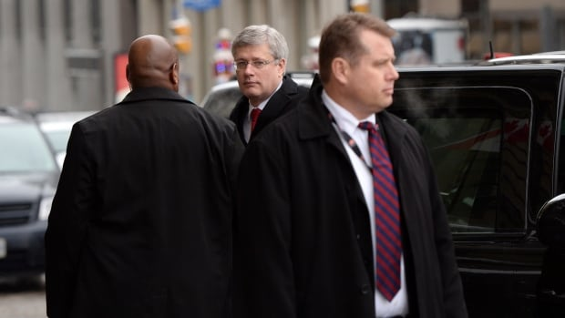 Prime Minister Stephen Harper, centre, shown Monday, said in mid-December that there was 'no doubt that the government will balance its budget next year.' However, a TD economist says in a research note released Tuesday that the government's fiscal outlook is much weaker than predicted in the fall fiscal update.