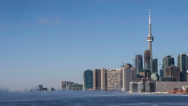 The Toronto skyline is pictured with a frozen section of Lake Ontario on Tuesday January 7, 2014. Royal LePage predicts that prices will continue to accelerate rapidly in Toronto in 2015 for a variety of reasons, among them a surge in demand for Ontario's exports thanks to the lower loonie and the robust economy south of the border.