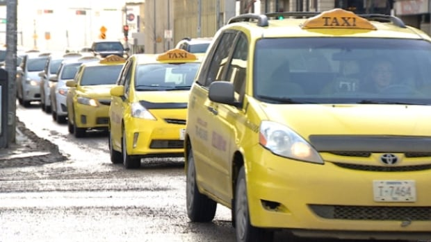 About 100 taxi drivers brought their cars to city hall on Wednesday to protest the presence of Uber in Edmonton.