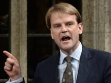"Chris Alexander reacts to a crowd at a Rebel Media hosted anti-carbon tax rally, as they begin to chant ""Lock her up."""