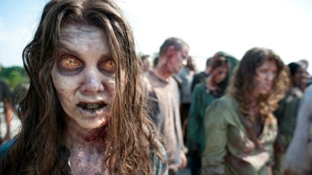 Zombies appear in a scene from the second season of the AMC original series, The Walking Dead.