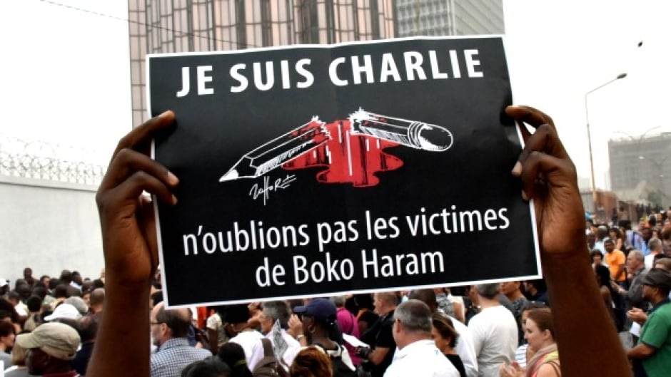 A man holds a placard that reads 'Je suis Charlie, n'oublions pas les victimes de Boko Haram' (I am Charlie, let's not forget the victims of Boko Haram) as people gather outside the French embassy in Abidjan. (Sia Kambou/AFP/Getty Images)