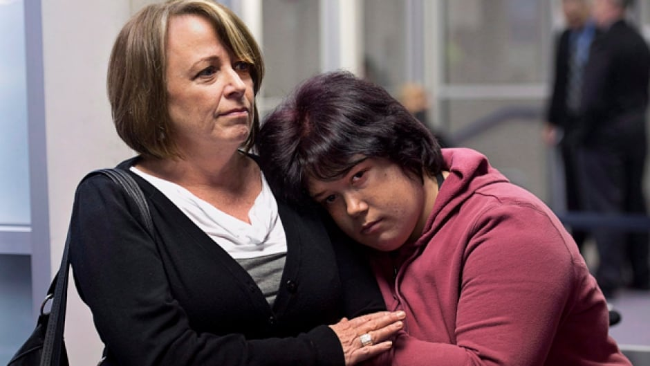 Nichelle Benn, right, and her mother Brenda Hardiman wait at provincial court in Dartmouth, N.S. Benn is facing charges after an incident at the rehabilitation facility where she lives. Hardiman says her daughter's brain disorder causes periodic episodes of aggressive behaviour. (CP/Andrew Vaughan)