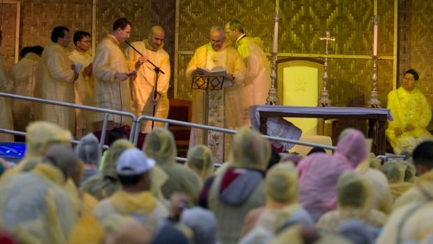 Pope Francis celebrates a Mass in Tacloban, Philippines, Saturday to comfort survivors of a devastating 2013 typhoon, braving rains and heavy winds himself.