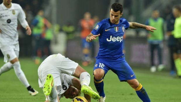 Sebastian Giovinco, right, of Juventus, has signed a contract with Toronto FC as another designated player, but won't be available to play in Canada until July 1.