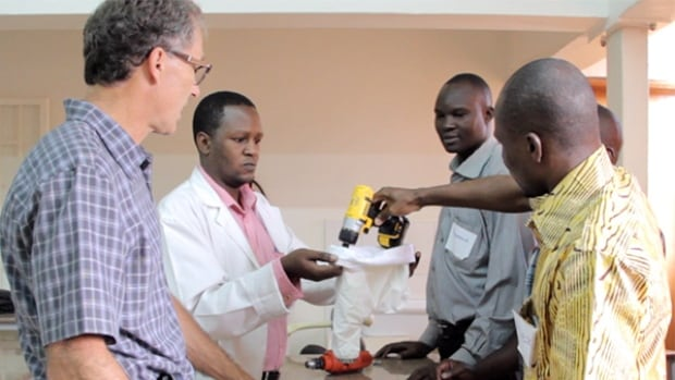 A workshop in Uganda teaching surgeons how to use the modified power drill developed by the team of biomedical engineers from UBC.