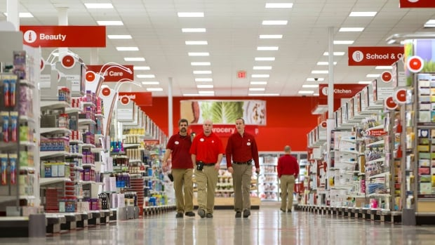 Employees walk through the new Target store in Guelph, Ontario, March
