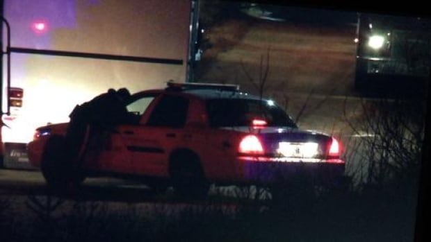 RCMP vehicle at the scene of an evacuation in the community of Grand Desert Tuesday night.