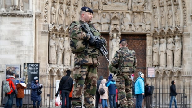 French soldiers patrol in front of the Notre Dame Cathedral in Paris on Tuesday after Islamist attacks that left 17 people dead.