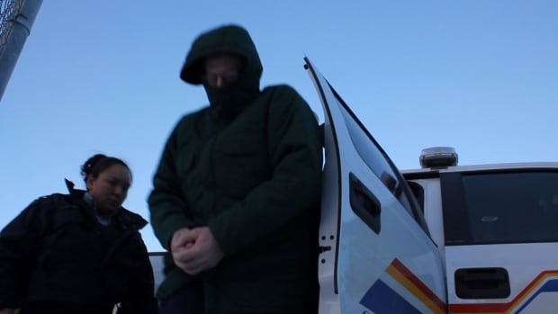 Eric Dejaeger steps out of an RCMP truck in front of the Nunavut Court of Justice in Iqaluit on Jan. 21.