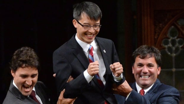 Then Liberal Leader Justin Trudeau and then MP Dominic LeBlanc (right) escort newly elected Liberal MP Arnold Chan to his seat in the House of Commons back in 2014. Chan died last week after a long battle with cancer.