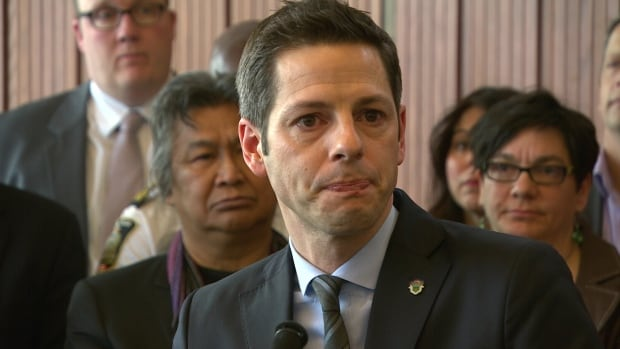 Winnipeg Mayor Brian Bowman addresses the media on Thursday, Jan. 23, 2015, about racism in Winnipeg, backed by prominent community leaders and activists. The event came on the heels of a Maclean's magazine article that labelled Winnipeg the most racist city in Canada.
