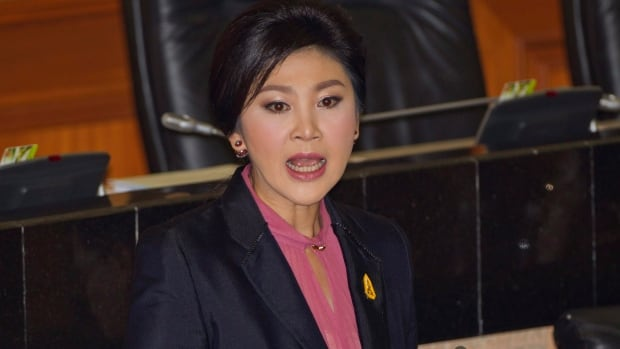 Thailand's former prime minister Yingluck Shinawatra, shown here answering a  question at parliament in Bangkok on Jan. 9. , was impeached by the country's military-appointed legislature on Friday.