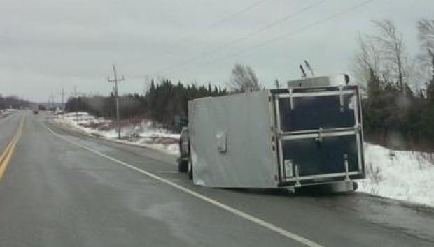 TCH Gander winds, upturned vehicle