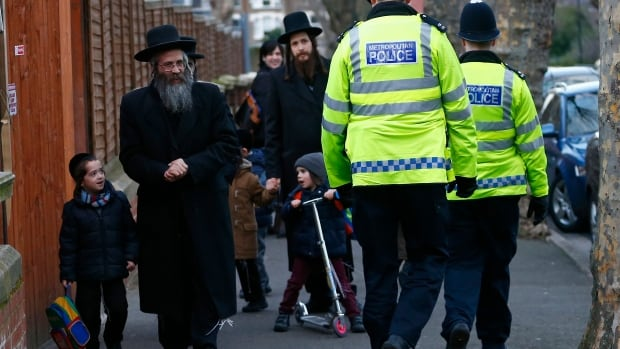 Members of the Jewish community collect their children from school in North London Jan. 20. Police have been working closely with Jewish organizations to step up security arrangements after the attack on a kosher supermarket in Paris earlier this month.