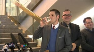 Mayor Brian Bowman drinks water