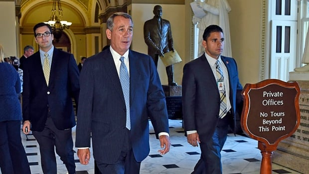 House Speaker John Boehner heads back to his office last month as the new Republican-controlled House voted on its first bills: One that would alter a key section of the 2010 Dodd-Frank Act, and the other that would block the president's executive actions on immigration.