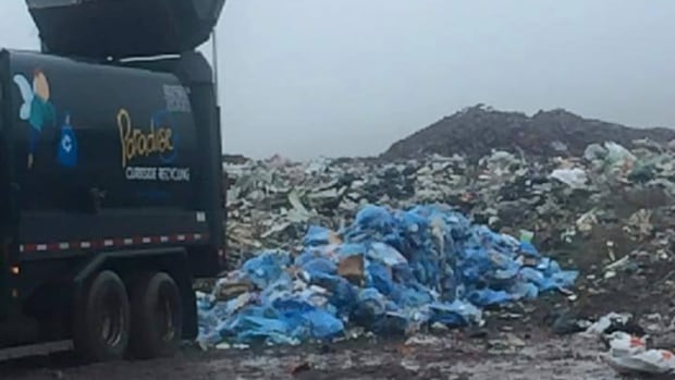 A garbage truck carrying a load of recyclables was forced to dump its load at the landfill, after a bag of dog poo exploded all over everything in the truck.