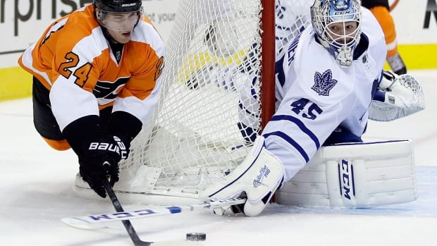 Goalie Jonathan Bernier, right, is seen here denying the Flyers' Matt Read during his Maple Leafs debut on Oct. 2, 2013, a 3-1 Toronto win. Bernier and the Leafs arrive in Philadelphia trying to snap an eight-game losing streak on Saturday night.
