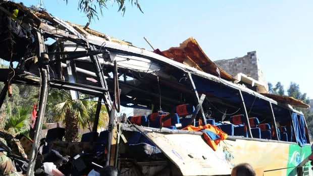 A bomb tore apart this Lebanese tour bus in Damascus, Syria, on Sunday, killing at least seven people. (AP Photo/SANA)