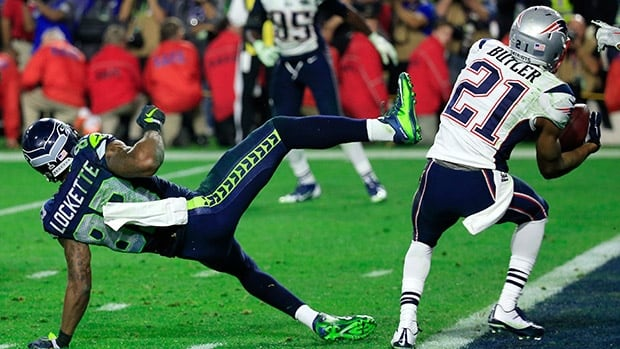 Patriots cornerback Malcolm Butler intercepts a pass by Seahawks quarterback Russell Wilson intended for Ricardo Lockette late in the fourth quarter during Super Bowl XLIX at University of Phoenix Stadium on Sunday in Glendale, Ariz.