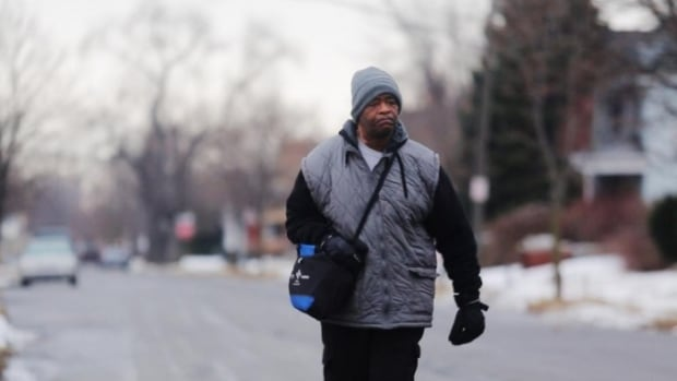 James Robertson, 56, of Detroit, walks nearly 34 kilometres every day as part of a commute to and from his factory job.