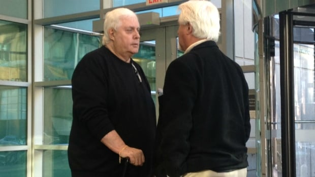 Gary Sorenson, left, stands with his brother in a Calgary courthouse.