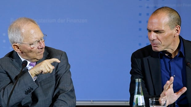 Talking past each other? Greek Finance Minister Yanis Varoufakis (right) and German Finance Minister Wolfgang Schaeuble meet the press after finance talks in Berlin last week. Having promised an end to five years of austerity, Greek officials are seeking support for a new debt agreement.