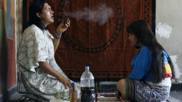A shaman performs a ritual treatment after drinking a beverage containing ayahuasca in Lima, Peru.