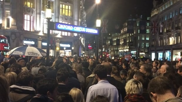 Hundreds of people are waiting outside the Oxford Circus underground station due to overcrowding on the subway trains and platforms, a daily occurrence during rush hour at many of London's busiest transportation stations.