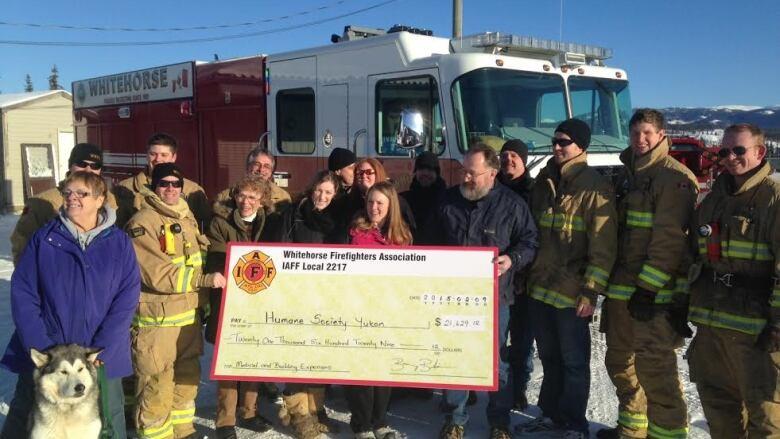 Firefighters calendar raises $21K for Whitehorse animal