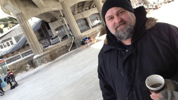 Chef and owner of Murray Street Kitchen Steve Mitton holds a cup of bone broth on the Rideau Canal.