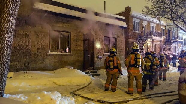 A woman was taken to hospital after a fire started in the kitchen of her single-storey home on Foucher Street.