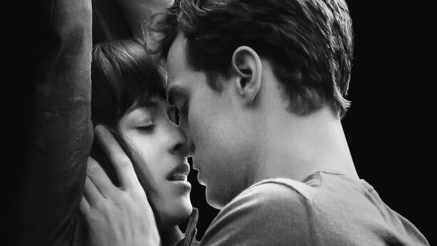 Jamie Dornan and Dakota Johnson embrace as Christian Grey and Anastasia Steele in the hotly-anticipated new movie Fifty Shades of Grey.