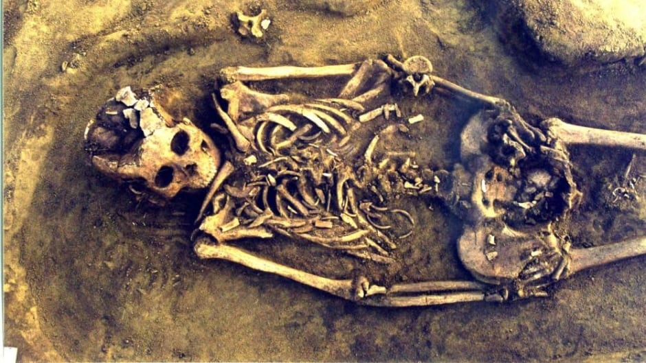 This Siberian mother died giving birth to twins.  The small bones in the pelvic region belong to the children.