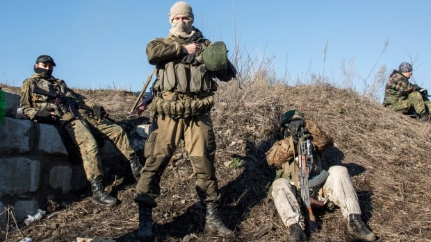 Russian-backed separatists wait for their transport, preparing to leave towards the frontline, in the village of Vergulivka, just outside Debaltseve, eastern Ukraine, on Friday, Feb. 13, 2015. Canada is preparing more support for Ukraine.