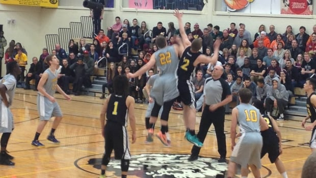The opening tip-off during the final game of the Luther Invitational Tournament between Regina's LeBoldus Golden Suns and Winnipeg's Garden City Gophers in 2015.