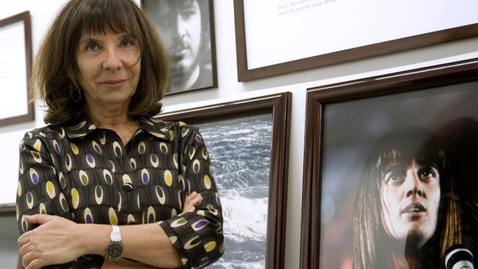 French artist Sophie Calle poses during a press conference before the opening of her exhibition called 'Wall Stories' at the Modern Art Museum in Medellin, Colombia, 2012.