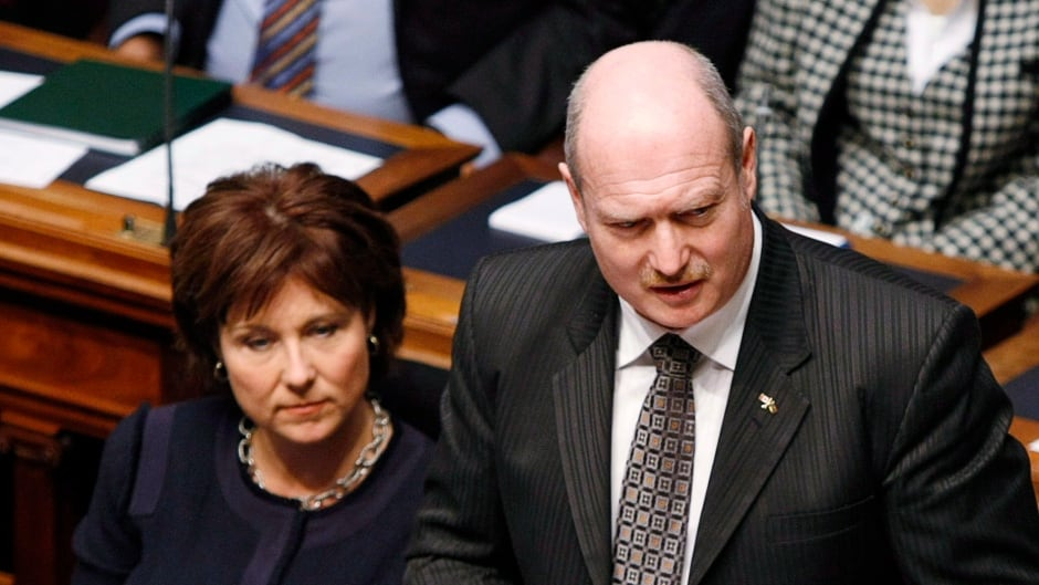 Premier Christy Clark (left) listens as B.C. Finance Minister Mike de Jong tables the provincial budget in the Legislative Assembly Tuesday, February 18, 2014 in Victoria, B.C.