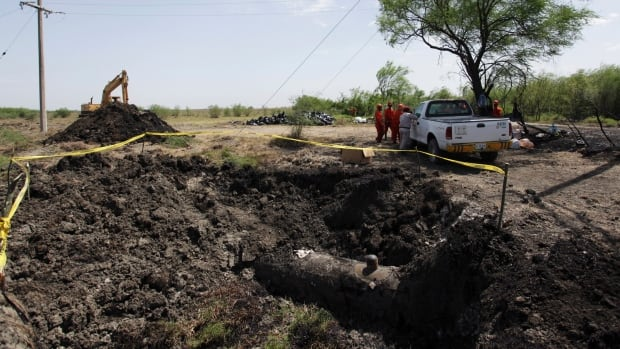 Part of a damaged oil pipeline awaits repair in Cadereyta in the Mexican state of Nuevo León last August. The pipeline ruptured when thieves attempted to tap into it.