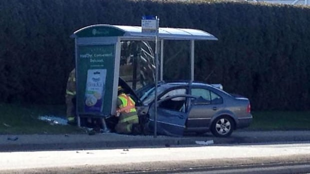 A woman has been rushed to hospital in critical condition and several others are injured after a car crashed into a bus shelter at Canada Way near BCIT.