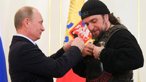 Russian President Vladimir Putin presents Alexander Zaldostanov with Russia's Order of Honour. Zaldostanov, described on Putin's website as 'head of a national motorcycle club,' has been added to a list of individuals under sanctions by Canada over Russian involvement in Ukraine.