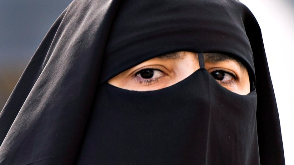 A woman wears a niqab as she walks Monday, September 9, 2013 in Montreal. THE CANADIAN PRESS/Ryan Remiorz