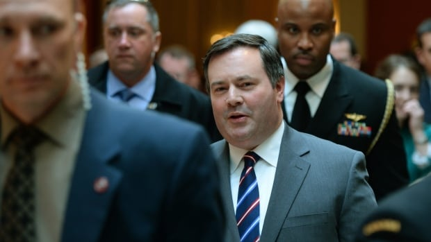 Defence Minister Jason Kenney, shown here leaving the Conference of Defence Associations Institute conference on security and defence in Ottawa on Thursday, said that departments always submit budgets 'with a little margin for error on the high side,' and always have carry forward provisions