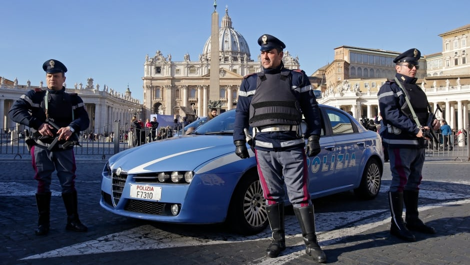 Italian policemen patrol in front of Saint Peter's Square in Rome. Media reports that American intelligence services have warned the Vatican that it could be the next target by Islamist militants have prompted alarm in Rome.