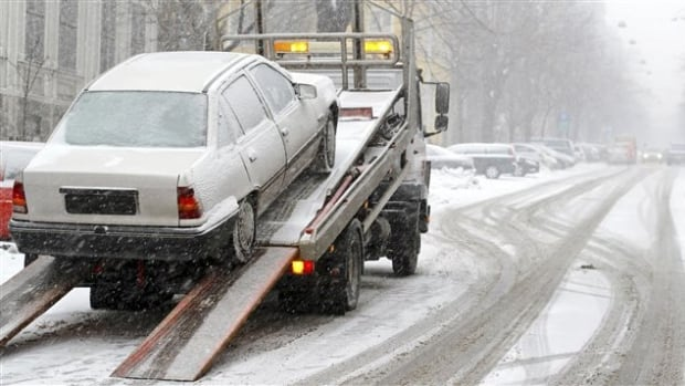 Close to 6,000 cars are towed from the streets during snow removal operations.