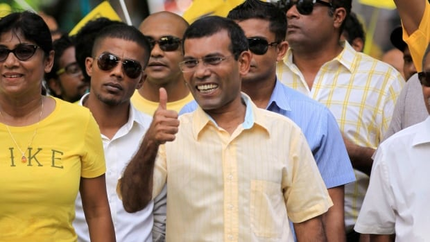 Former President and current opposition leader Mohamed Nasheed, centre, was arrested and ordered to stand trial for his 2012 decision to arrest a senior judge.