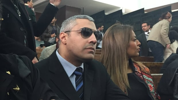 Mohamed Fahmy, left, is shown in court in Cairo on Monday beside his fiancée Marwa Omara.