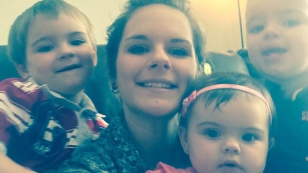 The body of Emanuelle D'amours, 24, was found early Wednesday morning in a Kapuskasing home. She is pictured here with her three children, Gabriel, 3, Maxim, 2, and Ava, 10 months.